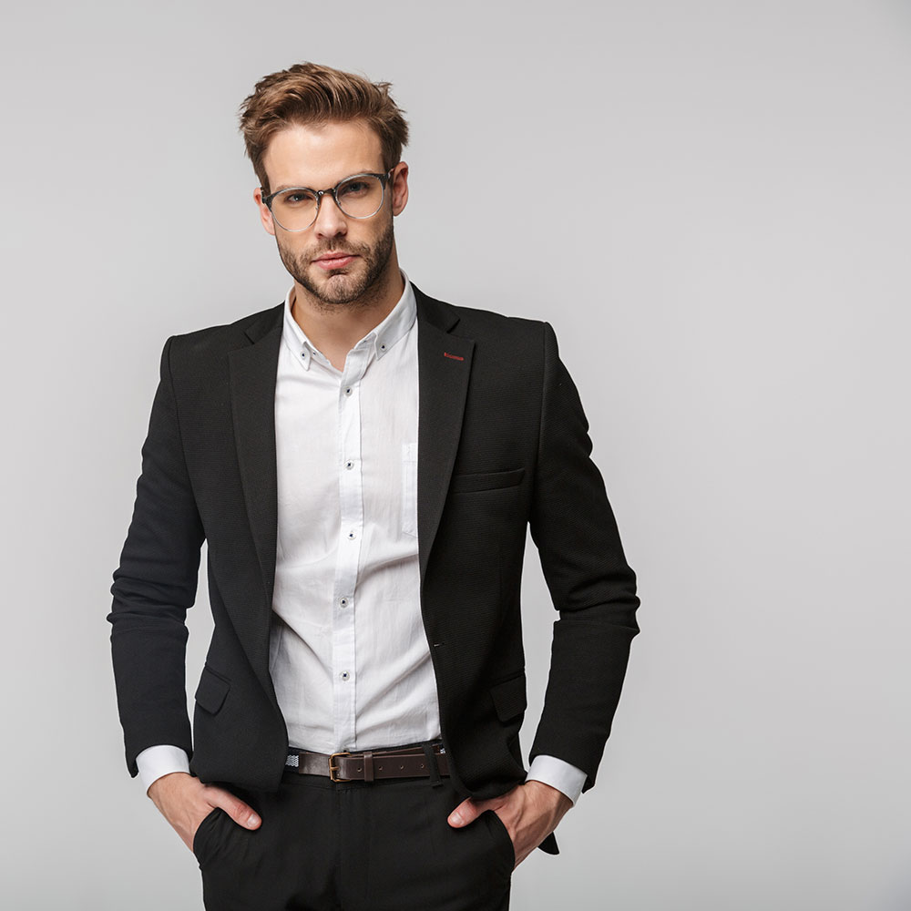portrait-of-handsome-businessman-posing-and-lookin-CMUZYHJ.jpg